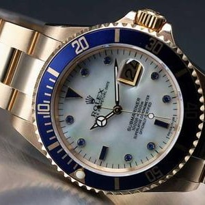 Swiss Rolex Submariner 18K Gold Case Pearl Dial Rubies Mens