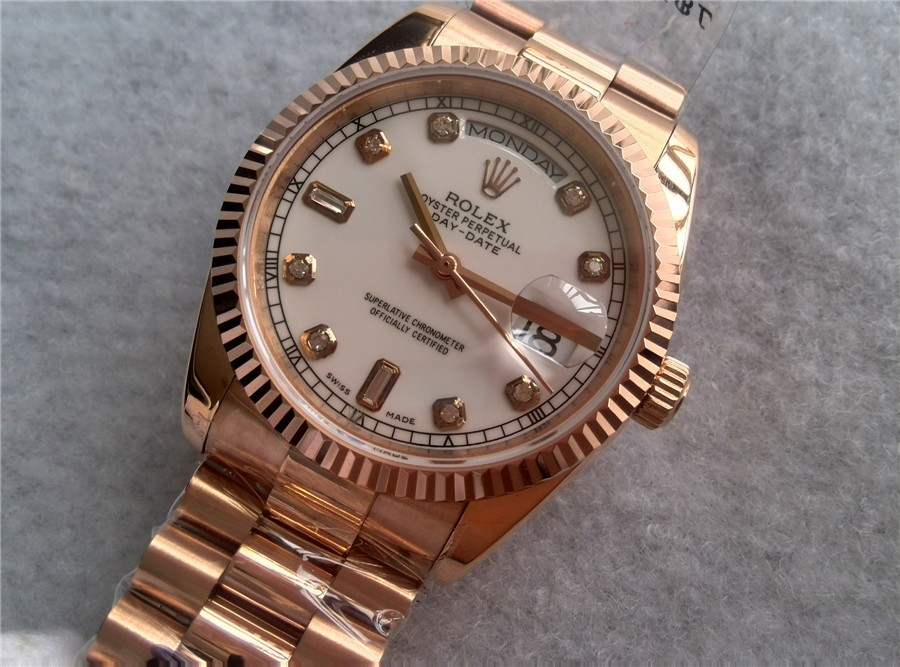 rolex day date automatic gold diamonds